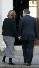 Britain's Chancellor of the Exchequer Brown and his wife Sarah return to 11 Downing Street in London.