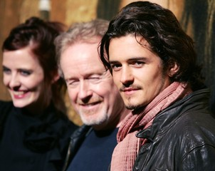 British actor Orlando Bloom poses with film director Ridley Scott and French actress Eva Green in Tokyo.