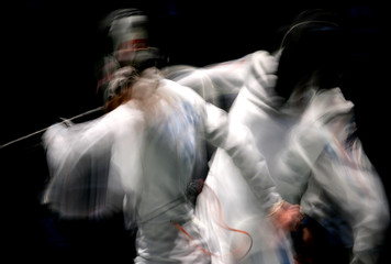 France's Kiraly Picot competes with Estonia's Embrich in their women's fencing individual epee qualifying event at the World Fencing Championship in Turin
