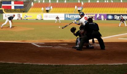 Dominican Republic's team two, Emilio Bonifacio bats against Venezuela during their fourth game in the Caribbean Baseball Series in Santiago