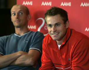 Andy Roddick of the U.S. and Nikolay Davydenko of Russia attend a news conference for the Kooyong Classic tennis tournament in Melbourne