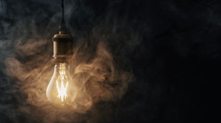 vintage glowing light bulb with smoke