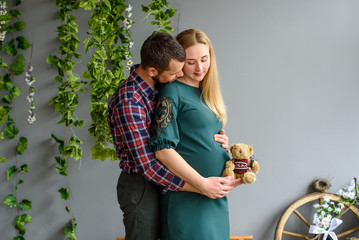 Happy kissing couple - pregnant woman and husband
