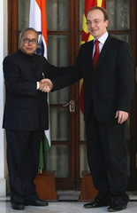 Macedonia's FM Milososki shakes hands with his Indian counterpart Pranab in New Delhi