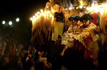 Members of the Krewe of Bacchus parade down St. Charles Avenue while celebrating the Mardi Gras weekend in New Orleans