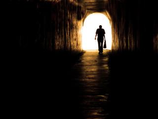 Old Man Walking Through Tunnel