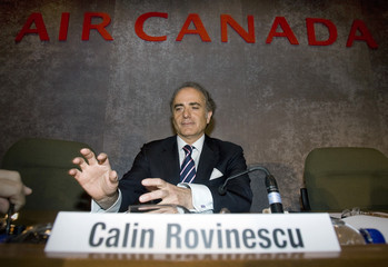 Rovinescu, president and CEO of Air Canada, waits for start of their annual general meeting in Montreal