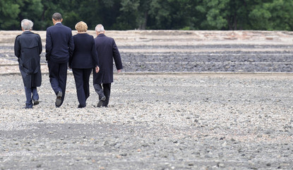 U.S. President Obama, German Chancellor Merkel, Holocaust survivors  Wiesel and  Herz walk down the gravel way to the little camp side at the former Buchenwald Nazi concentration camp