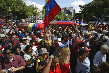 THOUSANDS MARCH WITH COFFINS IN CARACAS.