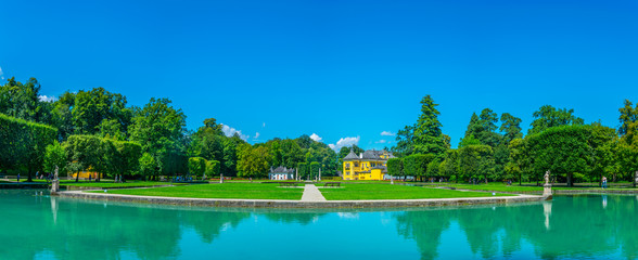 View of Hellbrunn palace, pond and garden near Salzburg, Austria.