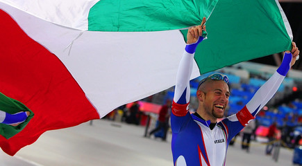 A member of Italy's team celebrate after winning the gold in the men's speed skating team pursuit race in Turin