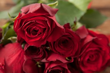 Bunch of red roses and gift box