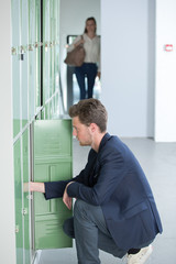 student opening lockers at the university