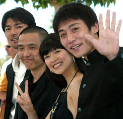 Chinese director Lou Ye (2nd L) stands with Chinese actor Liou Ye (R) and Chinese actress Zhang Ziyi..