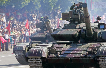 Tanks of Moldova's self-proclaimed separatist Dnestr region move during a military parade in ...