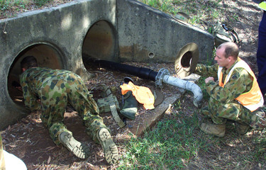AUSTRALIAN SOLDIERS CHECK THE DRAIN PIPES NEAR THE VENUE OF THIS WEEKSCOMMONWEALTH HEADS OF ...