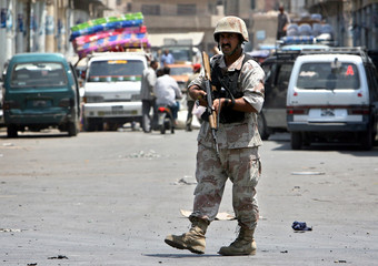 An Iraqi soldier secures the site of a car bomb attack in which one man was killed and 15 wounded in central Baghdad