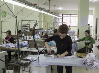 A worker irons shirts at a factory near Albania's capital Tirana