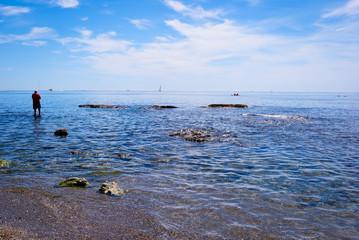 Pescador en el horizonte