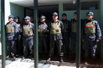 POLICE STAND GUARD IN PUNO.