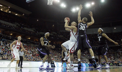 Beasley of Kansas State Wildcats tries to block shot of Stiemsma of Wisconsin Badgers during NCAA men's basketball championship game in Omaha