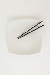 Pair of chopsticks on a plate