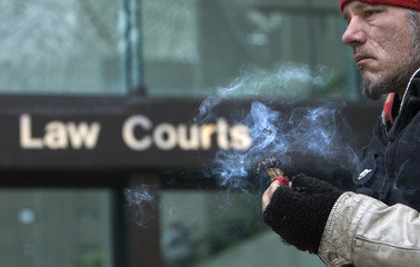 Protestor Ravenchild burns sweet grass outside courth house in Vancouver
