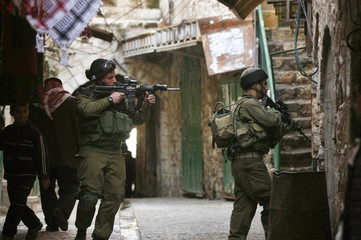 Israeli soldiers patrol the Old City of the West Bank city of Hebron