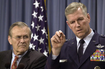 RUMSFELD AND MYERS SPEAK TO REPORTERS AT THE PENTAGON.