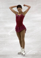 USA KWAN CELEBRATES FOLLOWING GOLD MEDAL WINNING SKATE AT WORLD CHAMPIONSHIPS.