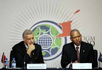 Commonwealth General Secretary Kamalesh Sharma and Trinidad and Tobago's Prime Minister PatrickManning attends a news conference at the venue of the Commonwealth Summit
