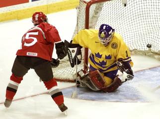 CANADIAN DANIELLE GOYETTE SCORES GOAL AGAINST SWEDENS LOTTA GOTHESSON.