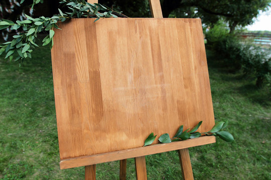 Copy space, your text here. Wooden easel with a board.