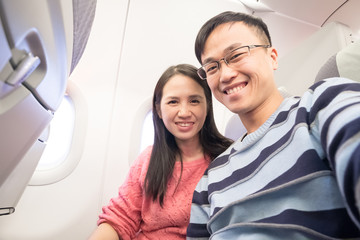 couple selfie in airplane