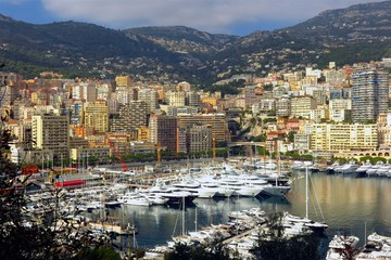 Monaco harbor Port Hercule yachts with mountain backdrop