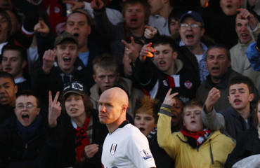 Kettering Town fans shout at Fulham's Johnson during their English FA Cup soccer match in Kettering