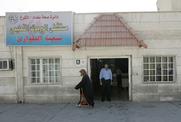 A policeman stands at the entrance to an emergency room in Yarmouk hospital in Baghdad