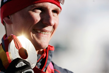 Germany's Hettich displays gold medal after winning Nordic combined individual Gundersen competition at Torino 2006 Winter Olympic Games in Pragelato