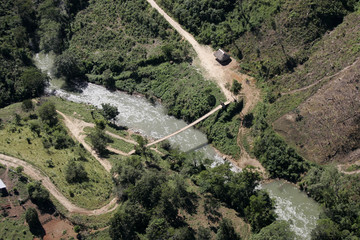 A foot bridge built by the Organization of American States (OAS) is seen in this aerial picture near the border with Belize