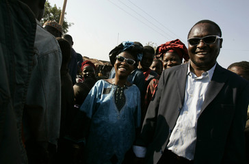 Blind Malian singing duo Amadou and Mariam go for a walk in Mali