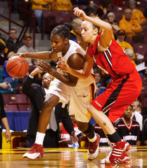 Southern California's Murphy drives past Louisville's Neal.