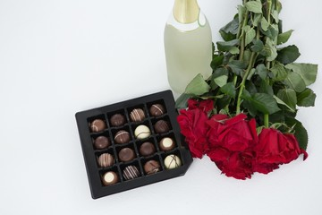 Gift, chocolate box, roses and champagne bottle