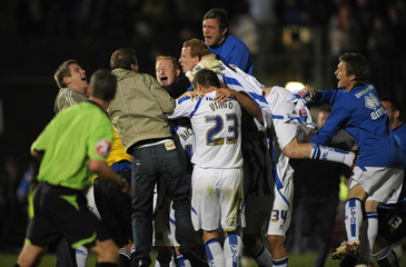 Brighton and Hove Albion players celebrate after beating Manchester City in their English League Cup second round soccer match at the Withdean Stadium in Brighton