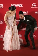 Hong Kong actor Nick Cheung and South Korean actress Kim Ji-yeong react as they arrive at the Asian Film Awards in Hong Kong