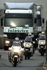 FRENCH POLICE ESCORT TRUCKS CARRYING EURO COINS AS THEY LEAVENATIONAL MINT IN PESSAC.
