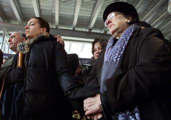 FAMILY MEMBERS OF VICTIMS OF WORLD TRADE CENTER AT PRAYER SERVICE ATGROUND ZERO.