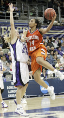 Bowling Green's Carin Horne takes a shot over Kansas State's Claire Coggins.