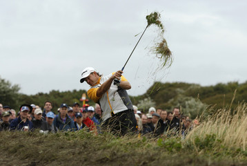 Goosen of South Africa plays a shot out of rough on 15th hole at 2008 British Open Golf Championship at Royal Birkdale, northern England