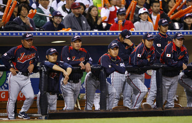 Team Japan members watch from the dugout loss against Team Korea in Round 2 of the World Baseball Classic in San Diego