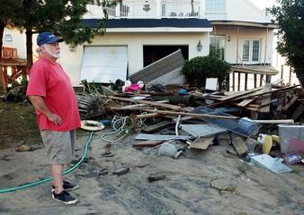 MAN VIEWS STORM DAMAGED HOME IN HAMPTON VIRGINIA AFTER HURRICANEISABEL.